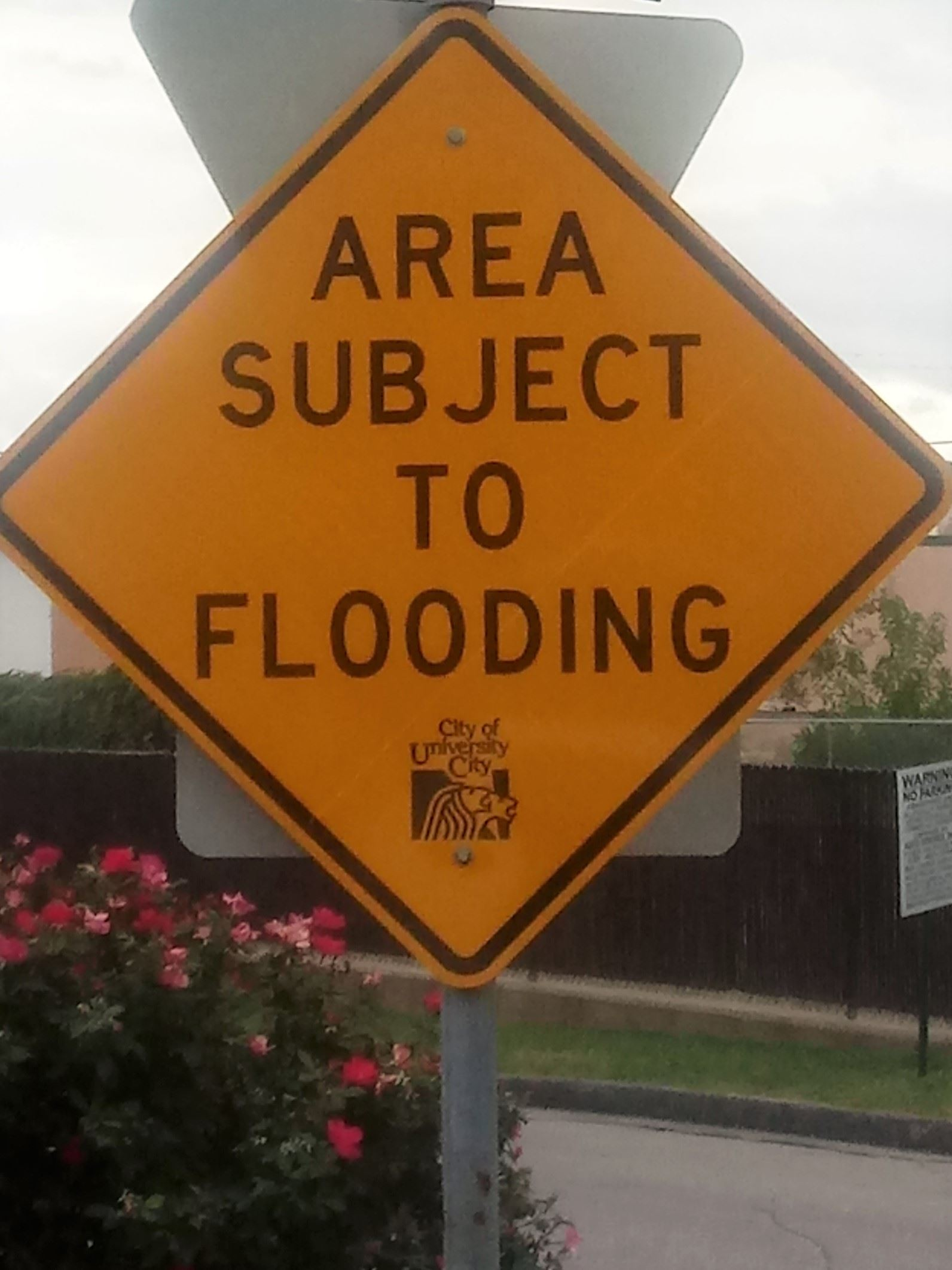 U City flood sign